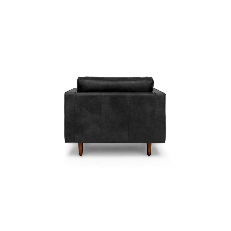 Стильное дизайнерское черное кожаное кресло Sven