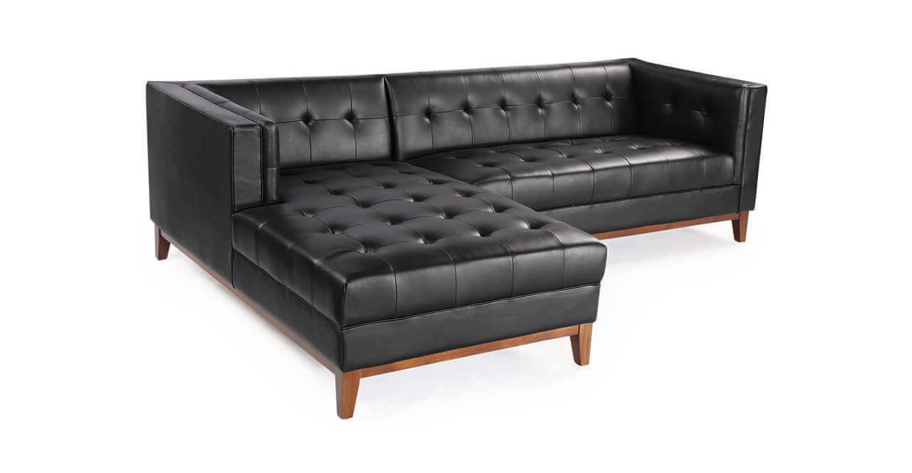 Угловой кожаный диван черного цвета